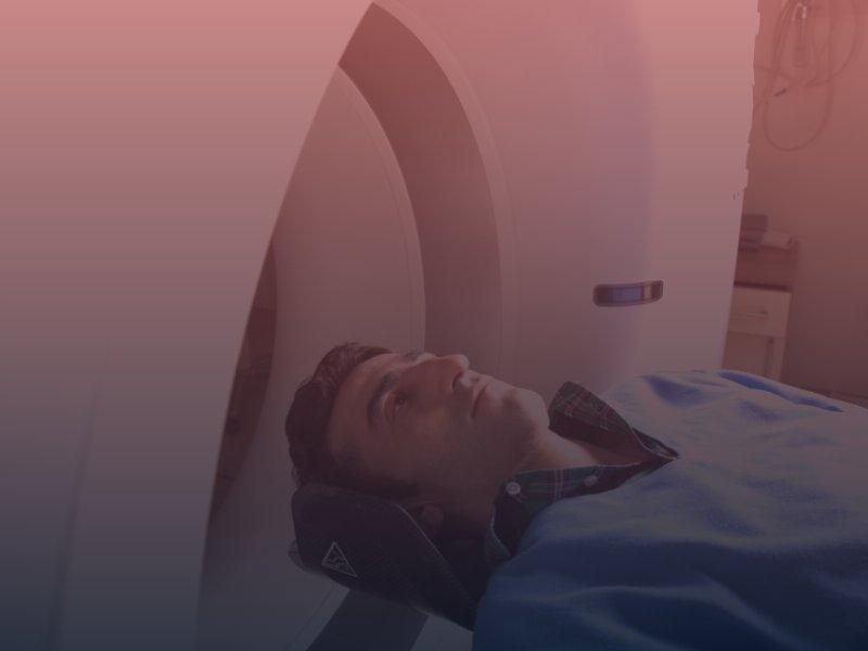 Man entering brain scan machine
