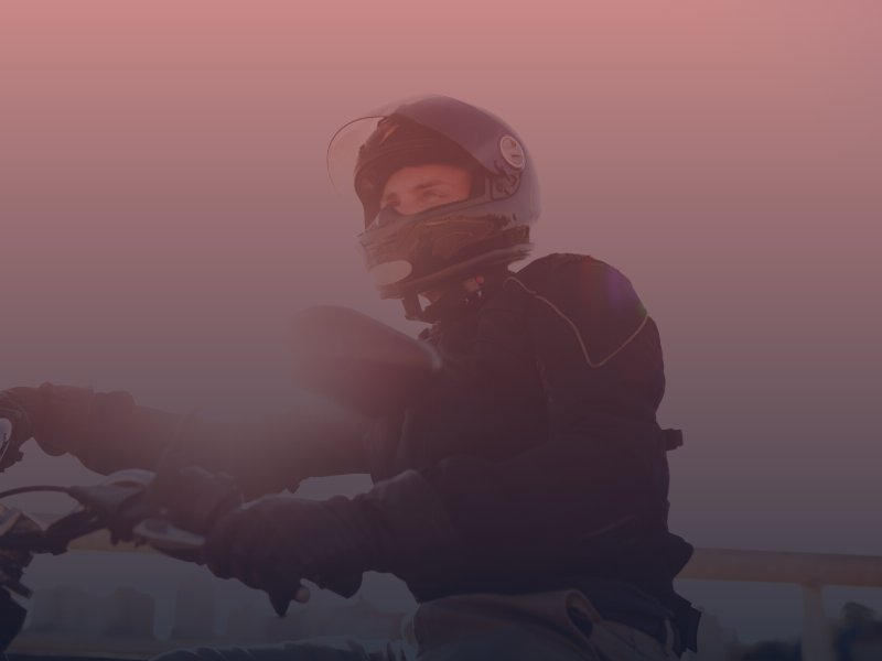 Man riding motorcycle with helmet